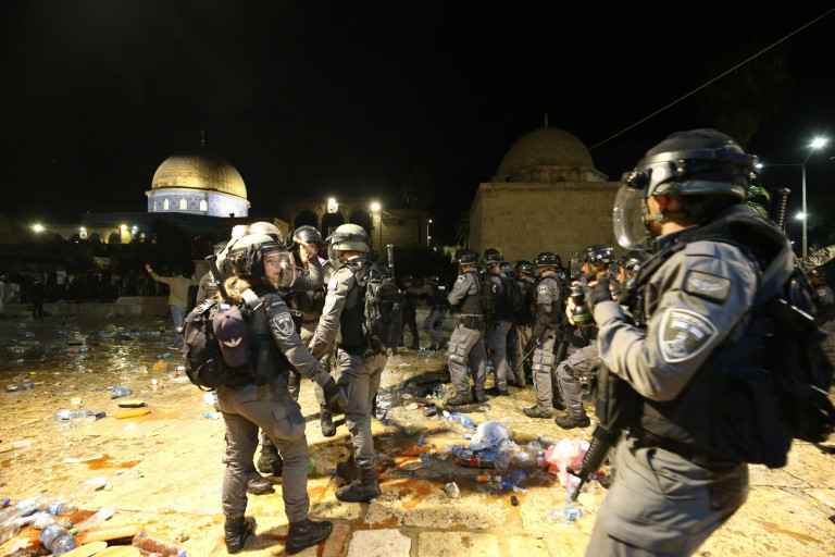 JERUSALEM - MAY 7: Israeli police intervene in Muslim worshippers with stun grenades and plastic bullets in Haram al-Sharif area of Al-Aqsa Mosque on Friday, on May 7, 2021 in East Jerusalem. The number of injured rose to 178 in Israeli attacks at Al-Aqsa Mosque, Damascus gate of the Old City and Sheikh Jarrah district in East Jerusalem on late Friday, the Palestinian Red Crescent said in a statement. Among the injured people, 88 were taken to hospitals in Jerusalem, while others were outpatient, the statement said. Most of the injuries were caused by rubber bullets fired by Israeli police, it added. (Photo by Mostafa Alkharouf/Anadolu Agency via Getty Images)