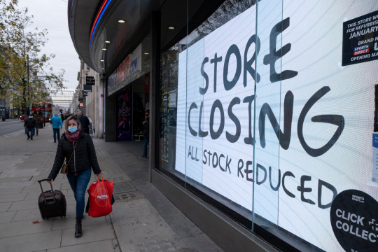 Store closing discounts as the national lockdown ends and the new three tier system of local coronavirus restrictions begins, shoppers head out to Oxford Street to catch up on shopping as non-essential shops like sport retailer Sports Direct are allowed to reopen on 2nd December 2020 in London, United Kingdom. Many shoppers wear face masks outside on the street as a precaution as there are so many people around. (photo by Mike Kemp/In Pictures via Getty Images)