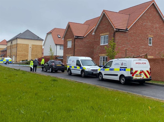 Police and forensics teams search a property in Aylesham, May 8 2021.