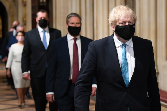 Prime Minister Boris Johnson (right) and Labour leader Sir Keir Starmer (2nd right) walk through the Central Lobby during the State Opening of Parliament in the House of Lords at the Palace of Westminster in London.