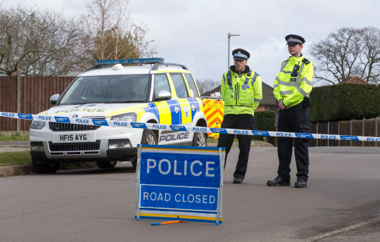 Theresa May visits Salisbury city centre, nearly two weeks after soviet spy, Sergei Skripal and his daughter, Yulia were attacked with a nerve agent there. Policemen standing by a road block near the home of Police Sergeant Nick Bailey, in Fordingbridge, Hampshire today. . REXMAILPIX.