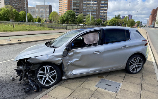 Peugot Summat suffered damage to its left side around the front wheel in the collision on Chester Road in Manchester.