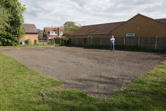 Craig Turner standing in the bit of the field used for the parking lot development next to his house. Craig Turner has complained to Barnby Moor Parish Council about a parking lot extension being built right next to his house.