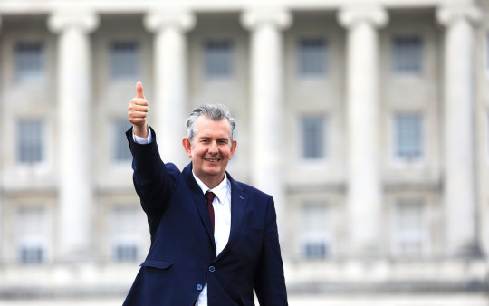 Democratic Unionist Party member Edwin Poots gives the thumbs up to the media outside Parliament buildings, Stormont after being elected as the new party leader in east Belfast, Northern Ireland Friday May 14, 2021. (AP Photo/Peter Morrison)