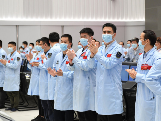 Mandatory Credit: Photo by Xinhua/Shutterstock (11904915a) Technical personnel celebrate after China's probe successfully landed on Mars at the Beijing Aerospace Control Center in Beijing, capital of China, May 15, 2021. The lander carrying China's first Mars rover has touched down on the red planet, the China National Space Administration (CNSA) confirmed on Saturday morning. It is the first time China has landed a probe on a planet other than Earth. China Beijing Tianwen 1 Probe Mars Landing - 15 May 2021