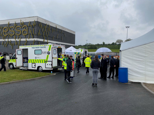 St John Ambulance vaccination volunteers at the ESSA Academy site in Bolton, where surge testing hopes to reveal magnitude of Indian variant