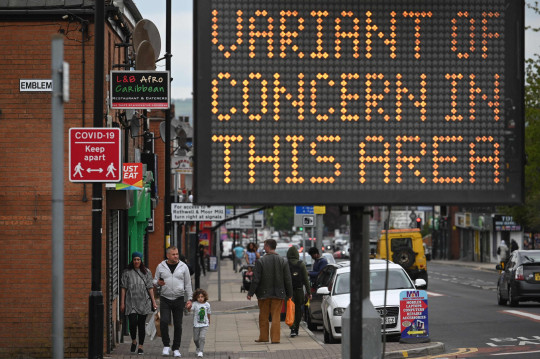 A digital sign warns the public of a 'Covid-19 variant of concern' in Bolton, where the Indian strain is feared to be spreading fast