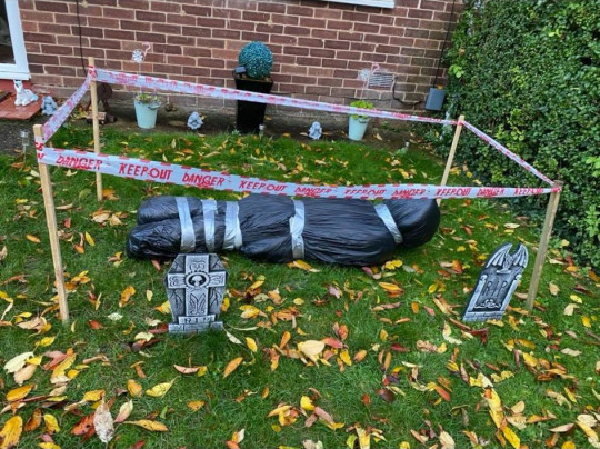 Mum-of-two Cara Louis was left horrified after cops swooped on her home thinking she was a MURDERER - after spotting an old Halloween prop in her garden. TEN police officers swarmed her home in Houghton Regis, Beds after THREE people spotted it and dialled 999. PIX: The fake body in halloween garden. TRIANGLE NEWS 0203 176 5581 // news@trianglenews.co.uk By Andy Crick With pix A MUM-of-two was left horrified after cops swooped on her home thinking she was a MURDERER - after spotting an old Halloween prop in her garden. Innocent Cara Louise used the fake corpse wrapped in bin liners for a spooky party for her kids last November. She stashed it away in her garden but moved it while doing some gardening and forgot to move it back as she rushed to collect her eldest son from school. TEN police officers swarmed her home in Houghton Regis, Beds after THREE people spotted it and dialled 999. But red-faced Cara, 28, was able to explain to the cops what had happened after she returned from the school run.