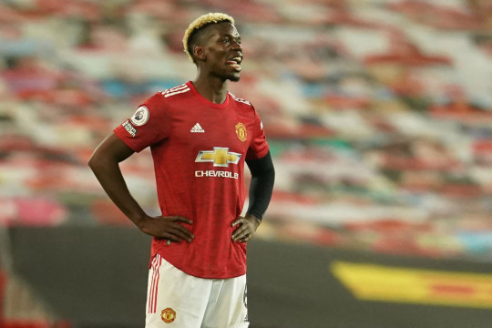 Paul Pogba looks on during Manchester United's clash with Liverpool