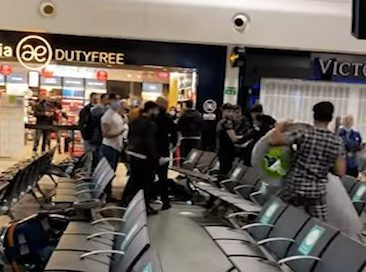 Man attempts to pick up bin during fight at Luton Airport on Friday morning