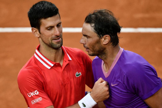 Spain's Rafael Nadal (R) greets Serbia's Novak Djokovic after defeating him in the final of the Men's Italian Tennis Open at Foro Italico on May 16, 2021 in Rome, Italy.