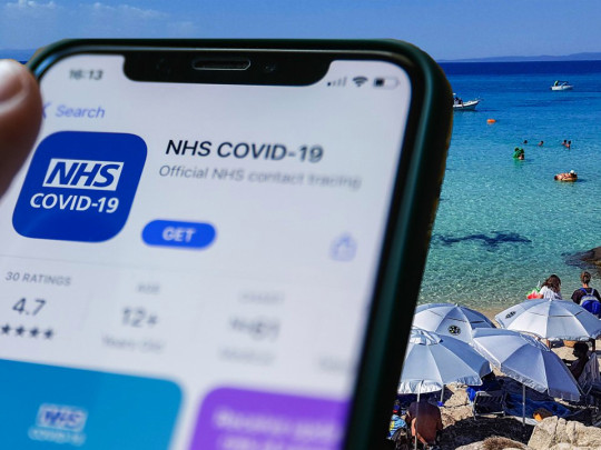 NHS app on an iphone at the beach
