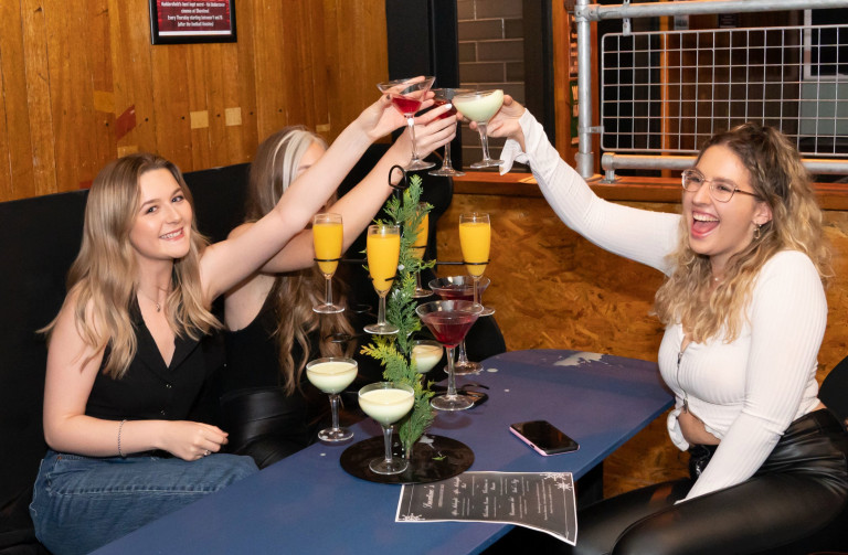 Left to right Rosie Delaney, Isobel Logan and Rebecca Mitchell enjoy their first drink inside the Showtime Bar at 00:11 in Huddersfield, West Yorkshire, as indoor hospitality and entertainment venues reopen to the public following the further easing of lockdown restrictions in England. Picture date: Monday May 17, 2021. PA Photo. See PA story HEALTH Reopening Pubs. Photo credit should read: Danny Lawson/PA Wire