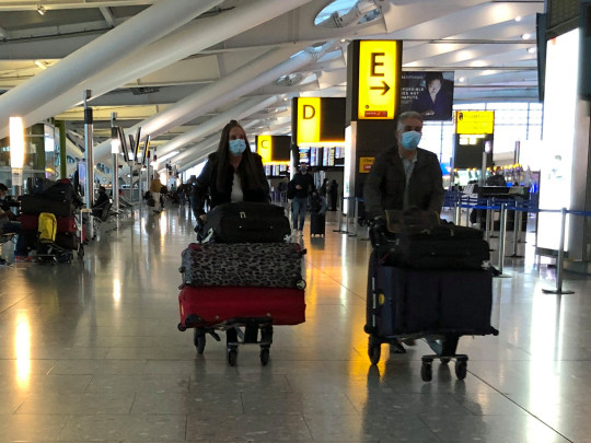w8media NO CREDIT The first passengers at heathrow airport terminal 5 departures taking advantage of the easing of covid-19 travel restrictions