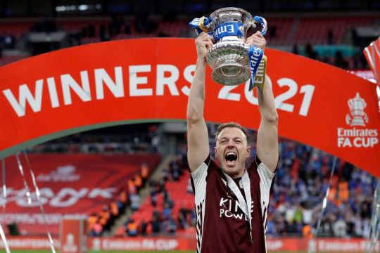 Jonny Evans celebrates with the FA Cup after Leicester's win over Chelsea