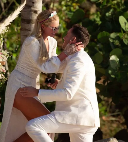 Paris Hilton with her new fiance Carter Reum, as he proposes