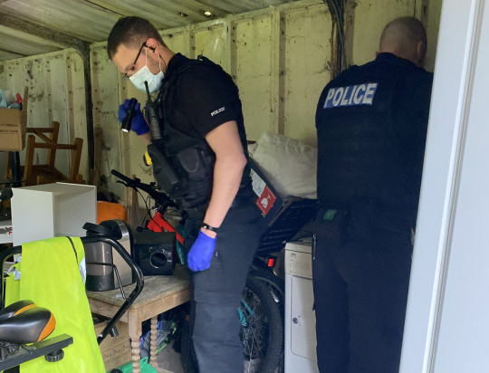 Police looking in a garage with flashlights. Pro-Palestine activists, who were arrested for occupying the roof of the Israeli-owned drone factory in Leicestershire, Elbit, 'have had their homes raided and their books seized by police'.