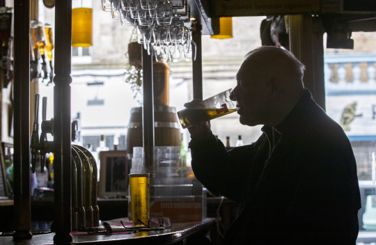 File photo dated 17/05/21 of a man drinking in a public house. Around six pubs have vanished for good from UK communities each week since the start of the first lockdown, according to new figures. Issue date: Monday May 24, 2021. PA Photo. Data compiled by real estate adviser Altus Group has revealed that 384 pubs have been demolished or converted for a different use over the past 14 months. See PA story CITY Pubs. Photo credit should read: Jane Barlow/PA Wire