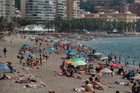 MALAGA, SPAIN - 2021/05/16: Bathers are seen sunbathing at Malagueta beach on a foggy day. Spaniards live their first weekend without mobility restrictions and curfew since the end of state of alarm in the country due to stabilization of coronavirus disease. The increase of massive vaccinations have provoke an decrease of infections and outbreaks in Spain. (Photo by Jesus Merida/SOPA Images/LightRocket via Getty Images)