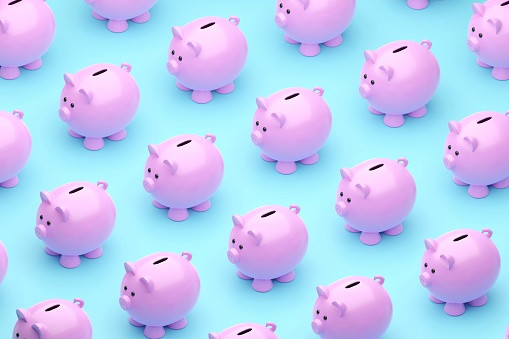 Many cute Piggy banks on blue background