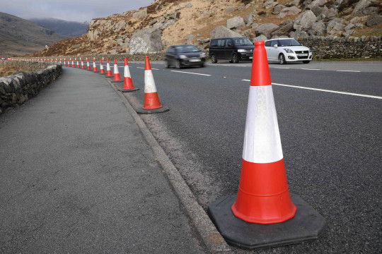Anti-parking measures installed along a popular Snowdonia route have been condemned as a hazard to motorists and pedestrians. Hundreds of traffic cones were put in place on either side of the A5 in the Ogwen Valley as a response to the parking chaos which enveloped the area last summer. Some people have since nicknamed the national park ?Snowconia? and bemoaned the visual blight of so much orange and white plastic. Ogwen Valley A5 cones out to stop visitor parking on the road and footpath over the Easter weekend in Gwynedd