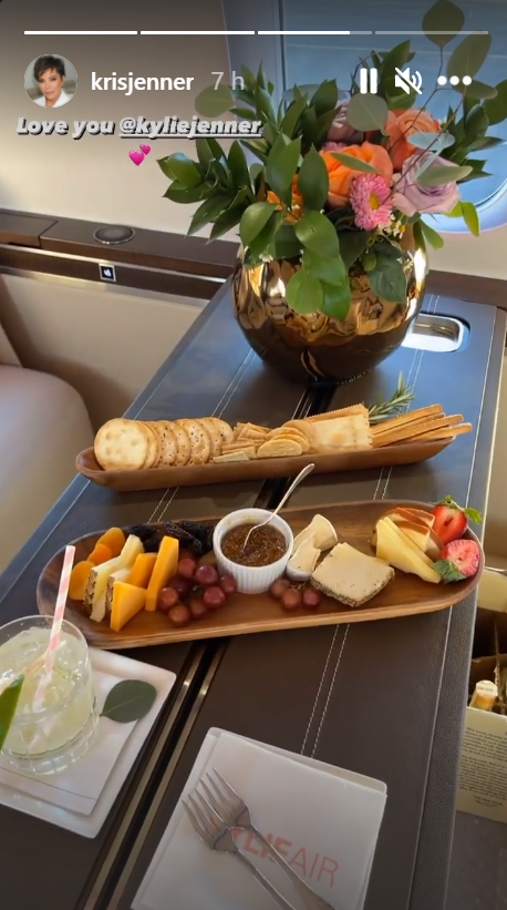 Kris Jenner's photograph of her charcuterie board and drink while onboard Kylie Air