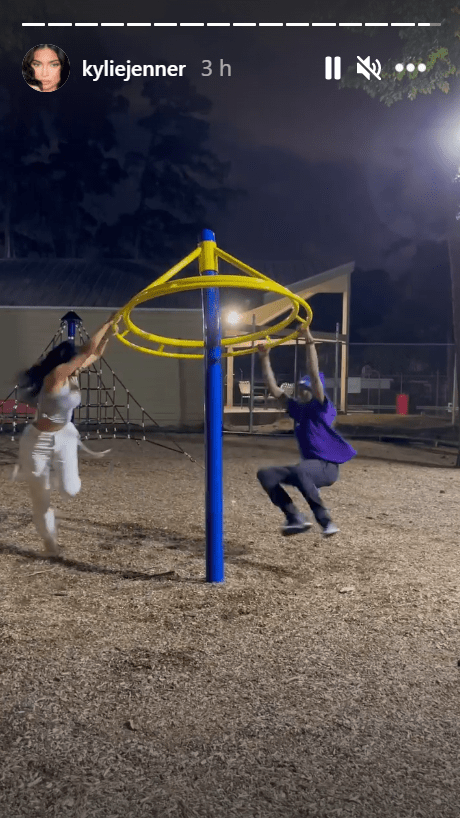 Travis Scott and Kylie Jenner on an outdoor jungle gym together