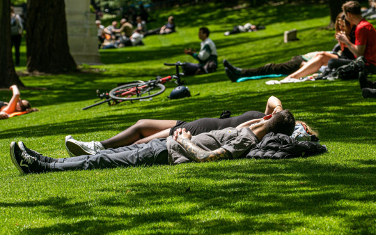 Mandatory Credit: Photo by Amer Ghazzal/Shutterstock (11975697c) Members of the public enjoying the warm sunshine in Victoria Embankment Gardens on a pleasant warm day in London as weather forecasters predict a sunny bank holiday weekend with temperatures reaching 23Celsius Seasonal Weather, London, UK - 27 May 2021