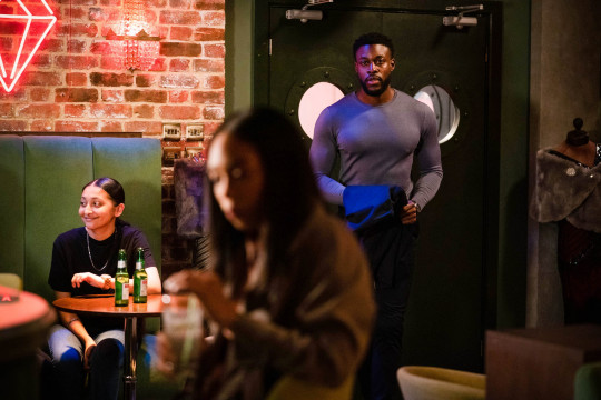 WARNING: Embargoed for publication until 00:00:01 on 18/05/2021 - Programme Name: EastEnders - April-June 2021 - TX: 28/05/2021 - Episode: EastEnders - April-June 2021- 6280 (No. 6280) - Picture Shows: ***HOLD BACK FOR DAY OF TX*** CAPTION: Knowing that Kim???s new man can???t be trusted, Chelsea has a plan to prove his true colours Chelsea Fox (ZARAAH ABRAHAMS), Dwayne (EMMANUEL OGUNJINMI) - (C) BBC - Photographer: Kieron McCarron/Jack Barnes