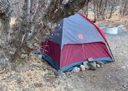 The woman has been living alone in the tent for six months