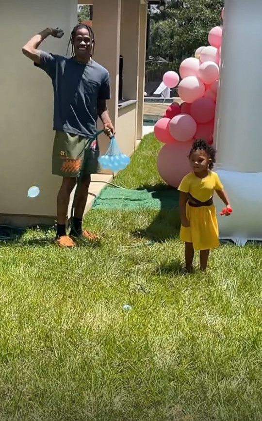 Travis Scott and Stormi Webster in water fight