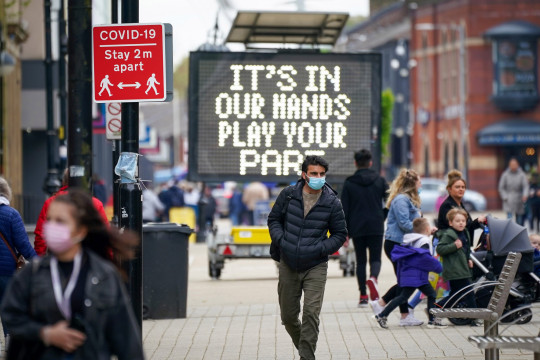 BOLTON, ENGLAND - MAY 26: People shop and go about their daily life in Bolton town centre as surge testing and rapid coronavirus vaccinations continue on May 26, 2021 in Bolton, England. The UK government amended earlier advice asking people to avoid non-essential travel to and from Bolton and seven other places in England experiencing spikes in Covid-19 cases. New guidance asks that people minimise travel to such places, whose local authorities were largely surprised by the initial rule change, published without fanfare on a government website on May 14. (Photo by Christopher Furlong/Getty Images)