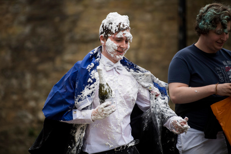 ? Licensed to London News Pictures. 04/06/2021. London, UK. A students at Oxford University covered in foam and holding a bottle of champagne after celebrating finishing final exams, in a tradition known as 'trashing'. Oxford University is attempting to clamp down on the tradition which sees students throwing food, confetti and drink over their classmates. Photo credit: Ben Cawthra/LNP