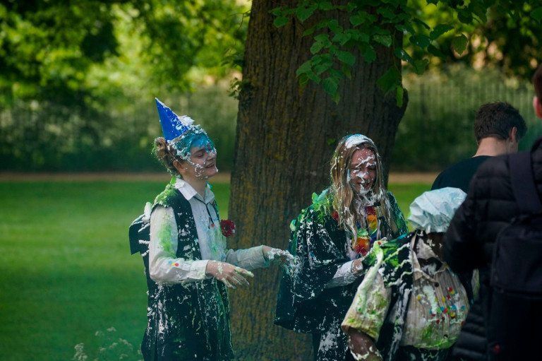Students at Oxford University by the River Cherwell next to Christ Church Meadow in Oxford, as they take part in the tradition of 'trashing' of throwing food, alcohol and confetti over each other after exams. The University and its colleges are trying to clamp down on the practice, with a campaign highlighting its impact on the environment, and the staggering cost of the clean-up afterwards. Picture date: Friday June 4, 2021. PA Photo. Photo credit should read: Steve Parsons/PA Wire