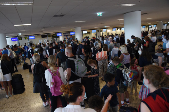 w8media A very busy Faro airport departures lounge in Portugal as people rush back to the uk prior to the new quarantine laws coming into force