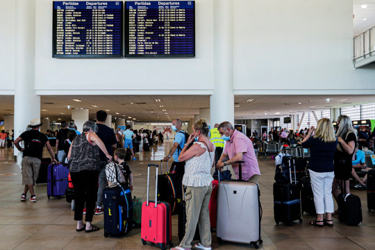 Brits queue for their flights at Faro airport after being told on Thursday that Portugal was being added to the amber list within days