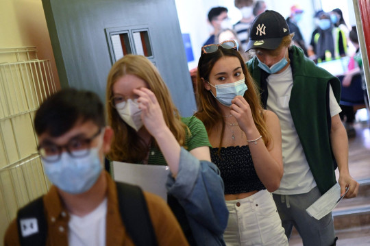 Students wait in a queue to receive a dose of the Pfizer/BioNTech Covid-19 vaccine at a vaccination centre at the Hunter Street Health Centre in London on June 5, 2021.