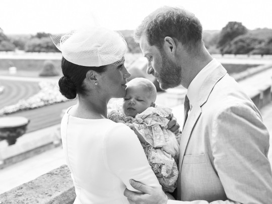 This official christening photograph released by the Duke and Duchess of Sussex shows the Duke and Duchess with their son, Archie Harrison Mountbatten-Windsor at Windsor Castle with with the Rose Garden in the background. PRESS ASSOCIATION Photo. Picture date: Saturday July 6, 2019. See PA story ROYAL Christening. Photo credit should read: Chris Allerton/??SussexRoyal NEWS EDITORIAL USE ONLY. NO COMMERICAL USE. NO MERCHANDISING, ADVERTISING, SOUVENIRS, MEMORABILIA or COLOURABLY SIMILAR. NOT FOR USE AFTER AFTER 31 DECEMBER, 2019 WITHOUT PRIOR PERMISSION FROM ROYAL COMMUNICATIONS. NO CROPPING. Copyright in this photograph is vested in The Duke and Duchess of Sussex. Publications are asked to credit the photographs to Chris Allerton. No charge should be made for the supply, release or publication of the photograph. The photograph must not be digitally enhanced, manipulated or modified in any manner or form and must include all of the individuals in the photograph when published.