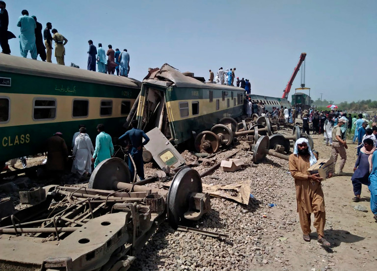 Soldiers and volunteers work at the site of a train collision in Ghotki district in the southern Pakistan, Monday, June 7, 2021. Two express trains collided in southern Pakistan early Monday, killing dozens of passengers, authorities said, as rescuers and villagers worked to pull injured people and more bodies from the wreckage.