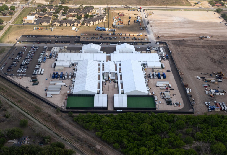 DONNA, TEXAS - MARCH 23: A temporary Customs and Border Protection processing center is seen from a Texas Department of Public Safety helicopter on March 23, 2021 in Donna, Texas. A surge of immigrants, including unaccompanied minors crossing into the United States from Mexico is overcrowding such centers in south Texas. (Photo by John Moore/Getty Images)