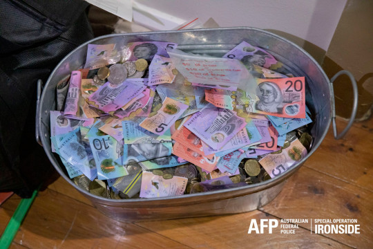 A bucket of money seized as part of the investigation