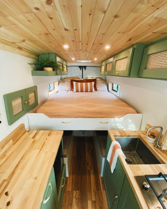 The couple's bed area in the van