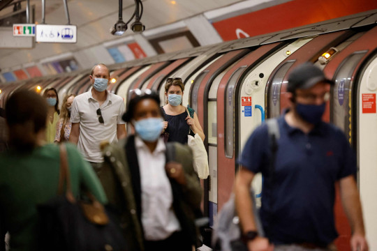 Commuters wearing face coverings due to Covid-19, travel on a Transport for London (TFL) Underground train in central London on June 7, 2021. - The Delta variant of the coronavirus, first discovered in India, is estimated to be 40 percent more transmissible than the Alpha variant that caused the last wave of infections in the UK, Britain's health minister said Sunday. (Photo by Tolga Akmen / AFP) (Photo by TOLGA AKMEN/AFP via Getty Images)