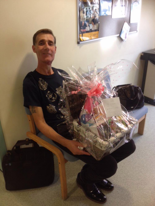 Mick after radiotherapy with a thank you hamper for his nurses. PA REAL LIFE/COLLECT