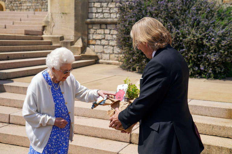 Queen Elizabeth II receives a Duke of Edinburgh rose, given to her by Keith Weed, President of the Royal Horticultural Society,, at Windsor Castle, Berkshire. The newly bred deep pink commemorative rose from Harkness Roses has officially been named in memory of the Duke of Edinburgh. A royalty from the sale of each rose will go to The Duke of Edinburgh's Award Living Legacy Fund which will give more young people the opportunity to take part in the Duke of Edinburgh Award. Picture date: Wednesday June 2, 2021. The Duke, who died in April this year, would have celebrated his 100th birthday on June 10th. PA Photo. See PA story ROYAL Philip. Photo credit should read: Steve Parsons/PA Wire