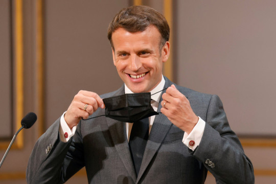 French President Emmanuel Macron smiles during the traditional Lily of the Valley ceremony at the Elysee palace in Paris, France May 1, 2021. Ludovic Marin/Pool via REUTERS