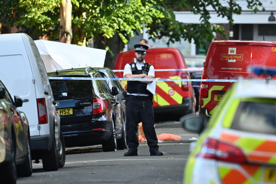 A police officer stands at a cordon in Streatham today
