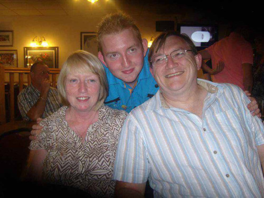 Adam, pictured here with his mum and dad