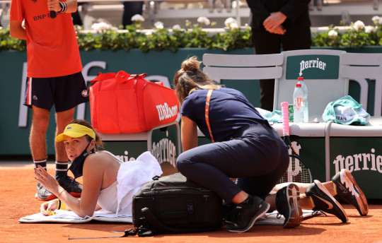 Anastasia Pavlyuchenkova of Russia receives treatment during the Women's Final on day fourteen of the 2021 French Open at Roland Garros on June 12, 2021 in Paris, France.