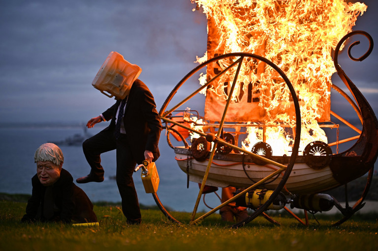 ST IVES, UNITED KINGDOM ??? JUNE 11: Ocean Rebellion activists set fire to a boat during the G7 summit in Cornwall on June 11, 2021 in St Ives, Cornwall, England. Environmental Protest Groups gather in Cornwall as the UK Prime Minister, Boris Johnson, hosts leaders from the USA, Japan, Germany, France, Italy and Canada at the G7 Summit in Carbis Bay. This year the UK has invited Australia, India, South Africa and South Korea to attend the Leaders' Summit as guest countries as well as the EU. Protest groups hope to highlight their various causes to the G7 leaders and a global audience as the eyes of the world focus on Cornwall during the summit. (Photo by Jeff J Mitchell/Getty Images) (Photo by Jeff J Mitchell/Getty Images)